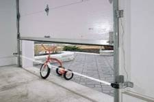 Bicycle under a closing garage door